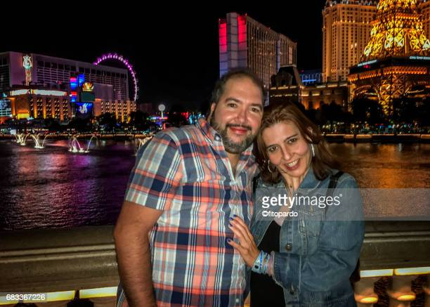 A couple posing in front of Las Vegas Strip