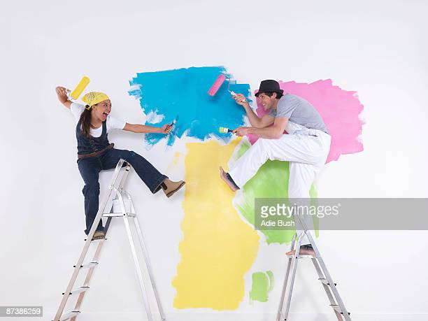 Couple posing on ladders.