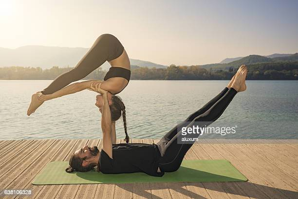 Couple practicing acroyoga in nature