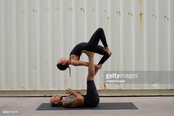 Couple Practicing Acroyoga