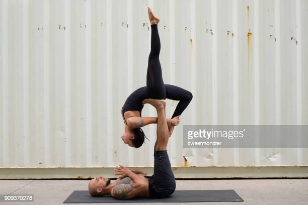 couple practicing acroyoga - acrobatic activity stock photos and pictures
