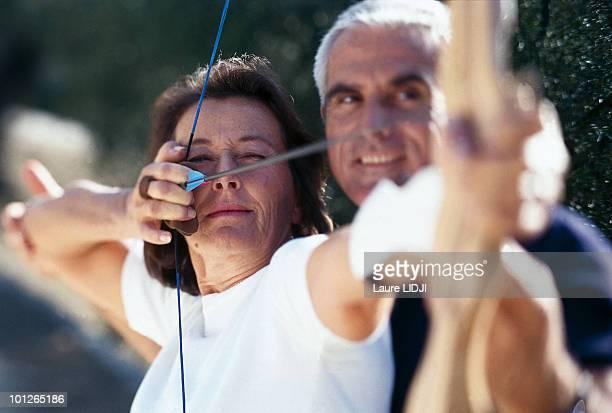 Couple practicing archery