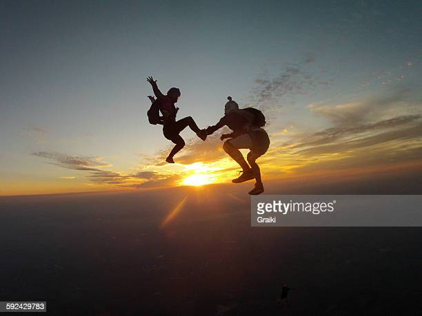 A couple practicing extreme sports