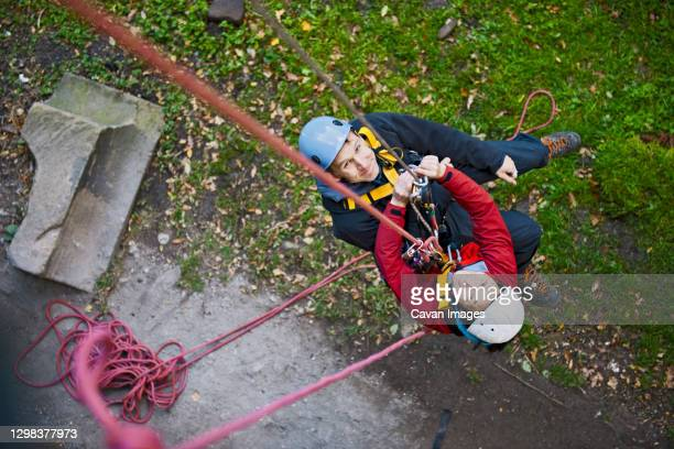 couple practising high rope rescue in the uk - sheffield stock pictures, royalty-free photos & images