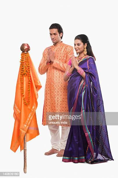 couple praying on gudi padwa festival - gudi padwa stock pictures, royalty-free photos & images