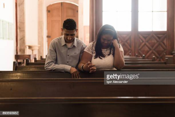 couple praying - religious mass stock pictures, royalty-free photos & images
