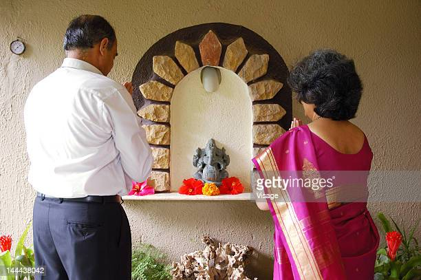 a couple praying together - hinduism bildbanksfoton och bilder