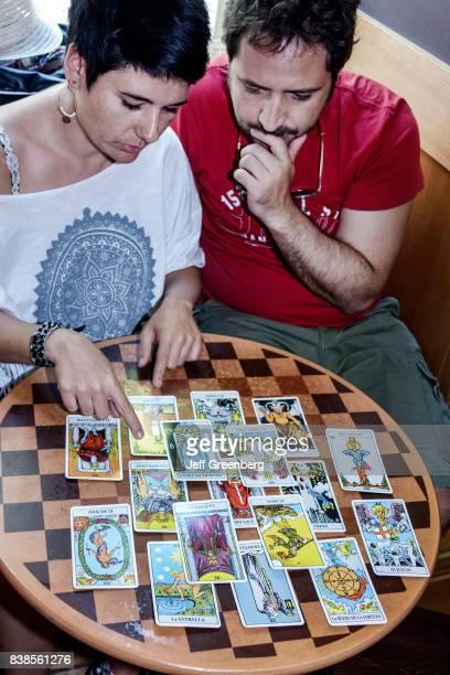 A couple predicting their future with Etteilla tarot cards