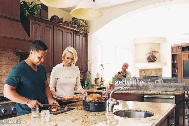Couple prepararing thanksgiving dinner