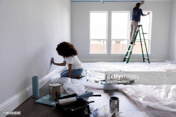couple prepare room for painting - nursery bedroom stock pictures, royalty-free photos & images