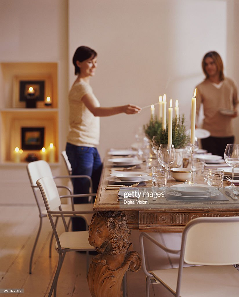 Couple Preparing a Dining Table for a Dinner Party : Stock Photo