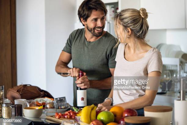 couple preparing food in kitchen - wife stock pictures, royalty-free photos & images