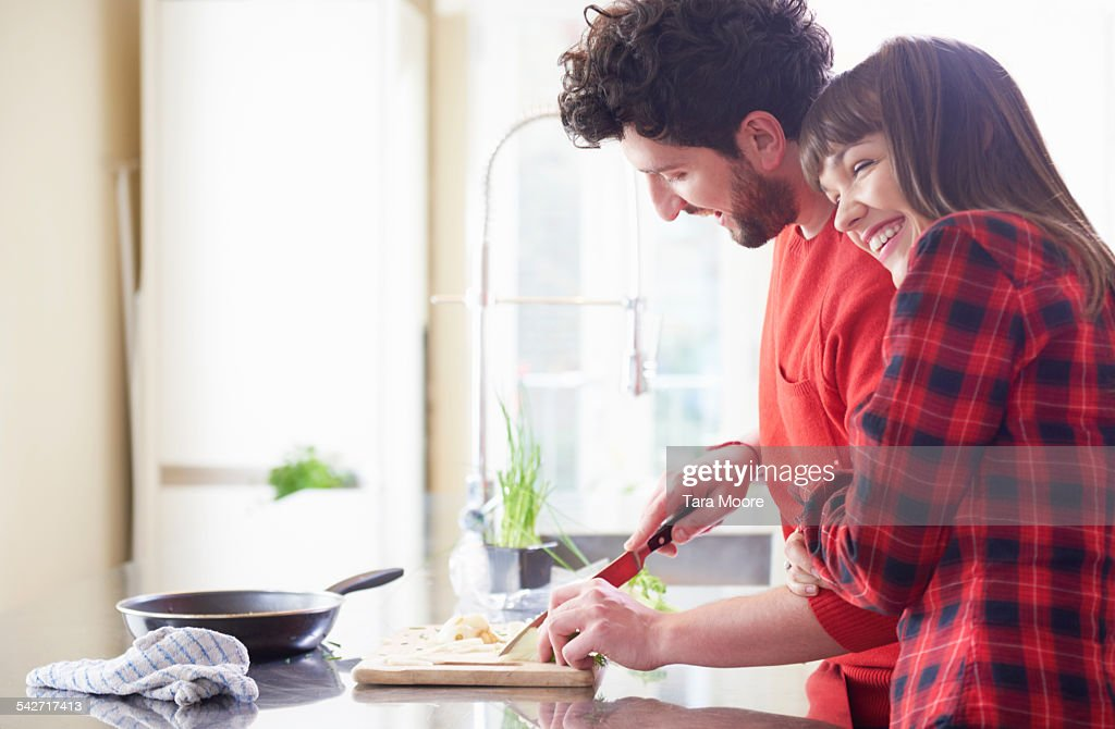 Couple preparing food in the kitchen : Stock Photo