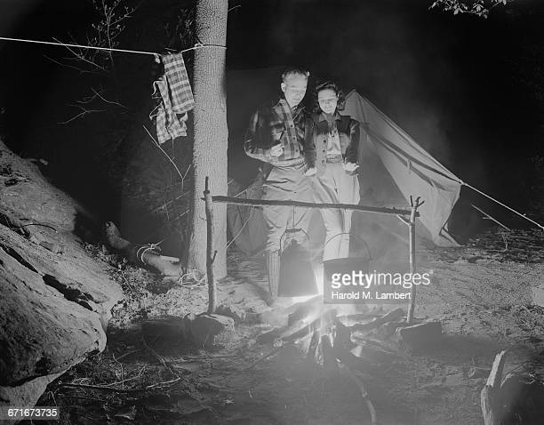 Couple Preparing Food On Camp Stove