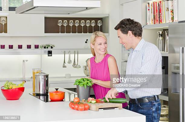 Couple preparing healthy meal in kitchen
