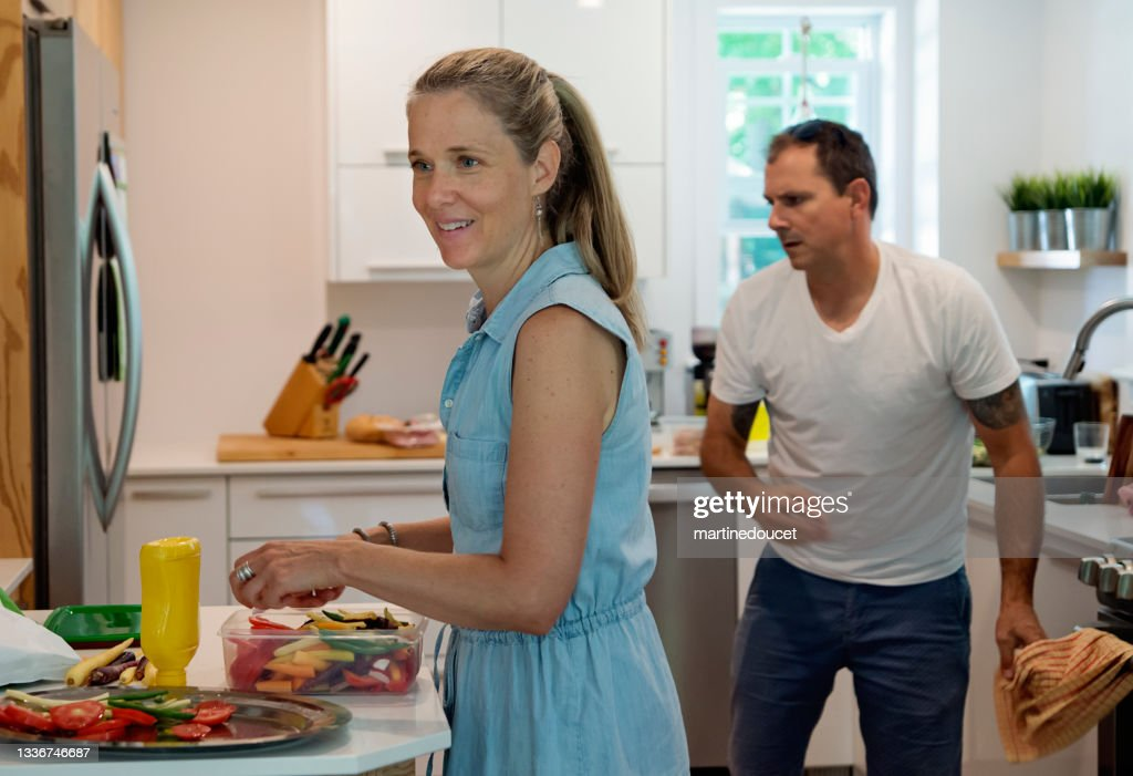 Couple preparing lunch in home kitchen. : Stock Photo