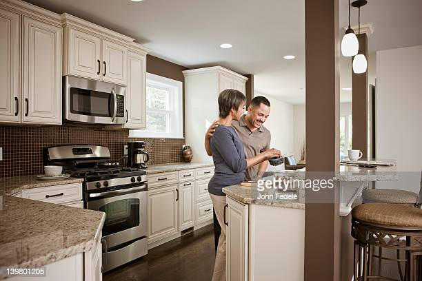 Couple preparing meal together in kitchen
