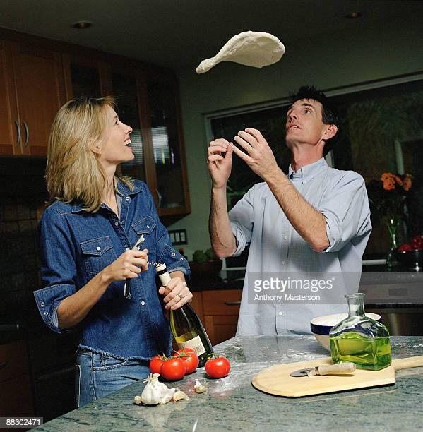 Couple preparing pizza