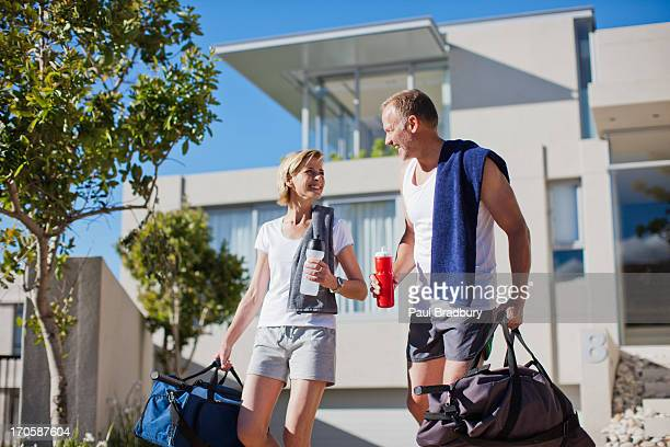 couple preparing to exercise - gym bag stock pictures, royalty-free photos & images