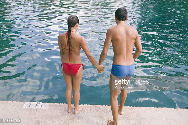Couple Preparing to Jump into Swimming Pool