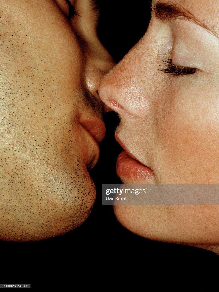 Couple preparing to kiss, close-up : Stock Photo
