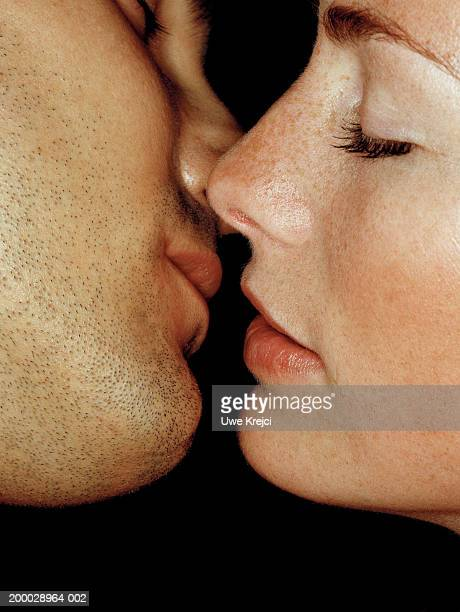 couple preparing to kiss, close-up - kissing stock pictures, royalty-free photos & images
