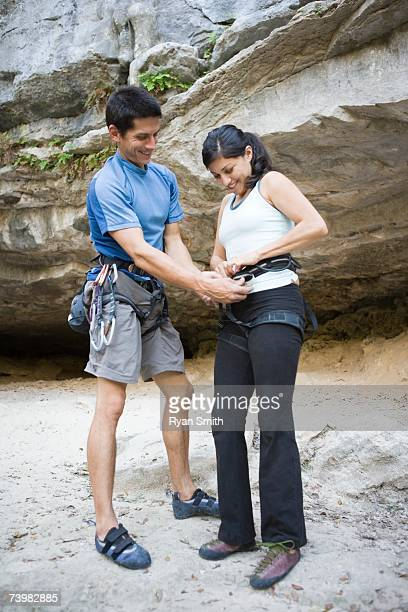 couple preparing to rock climb - chalk bag stock pictures, royalty-free photos & images
