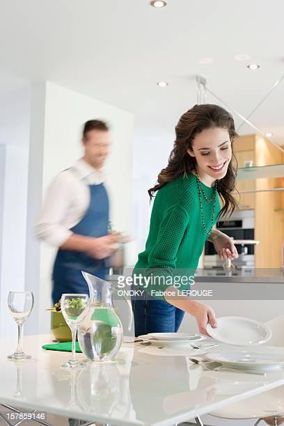 Couple preparing to serve dinner