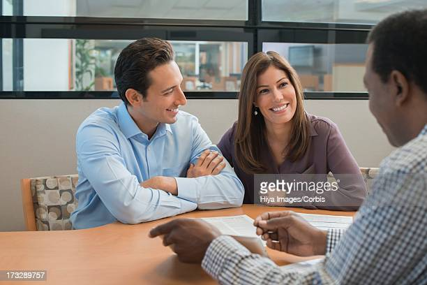 Couple preparing to sign loan contract