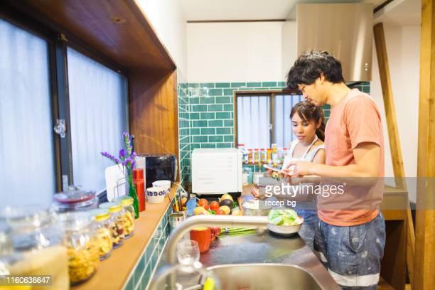 Couple preparing vegetarian food