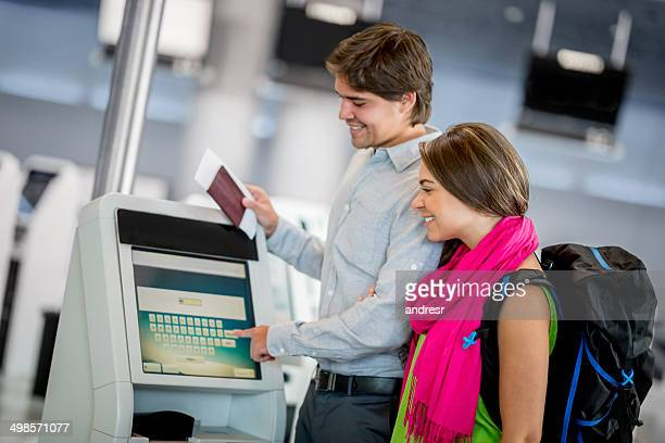 Couple printing thier boarding pass