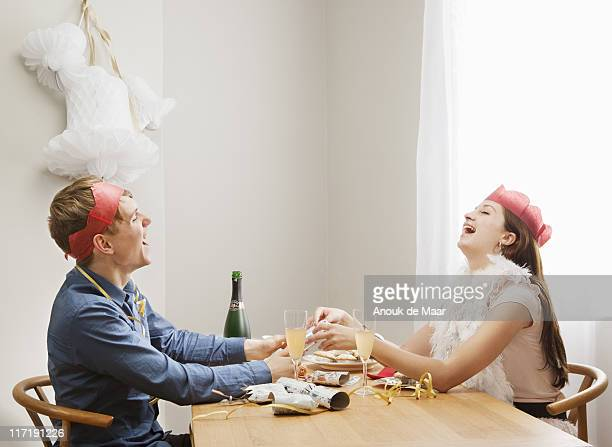 Couple pulling christmas crackers