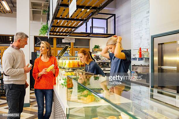 Couple Purchasing Healthy Refreshments
