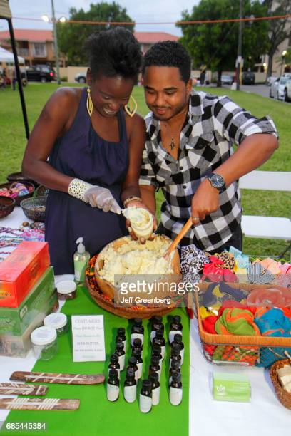 A couple putting shea butter into a jar at the Cultural Fridays monthly street festival