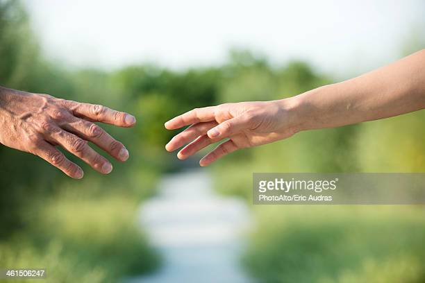 Couple reaching out to hold hands
