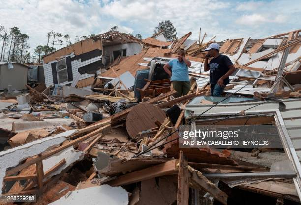 Couple react as they go through their destroyed mobile home following the passing of hurricane Laura in Lake Charles, Louisiana, on August 27, 2020....
