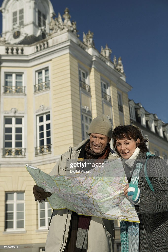 Couple Reading a Map : Stock Photo