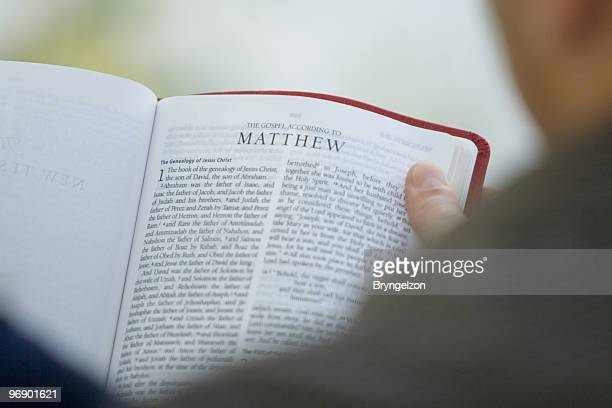 couple reading bible - gospel stock photos and pictures