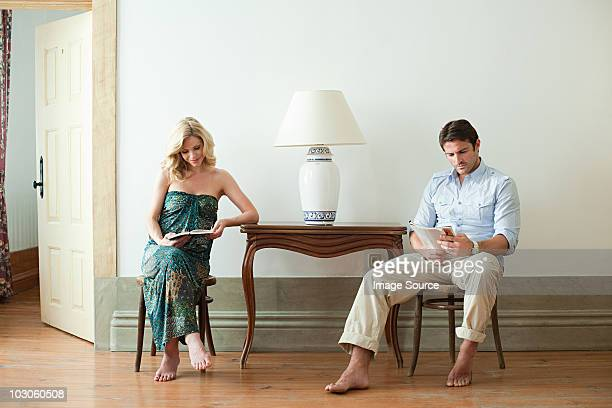 Couple reading in hotel room