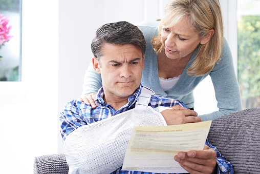 Couple Reading Letter About Husband's Injury 547129964