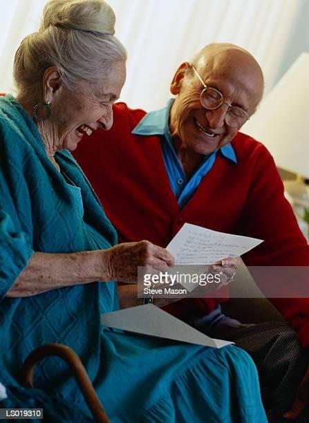 Couple Reading Letter