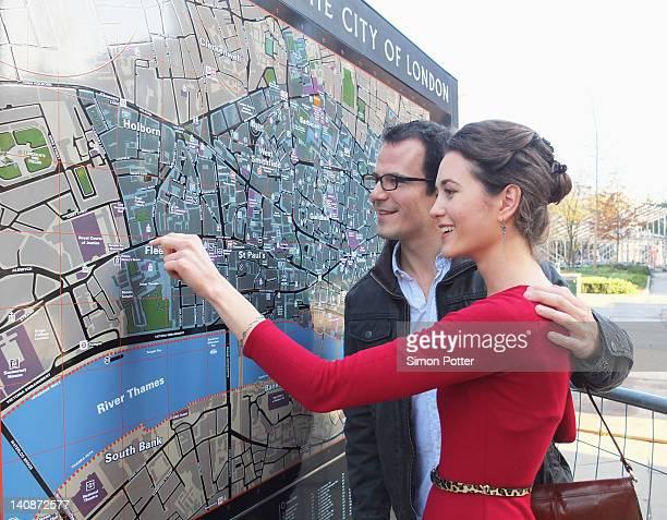 Couple reading London city map