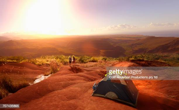 couple reading map near camping tent - waimea canyon stock pictures, royalty-free photos & images