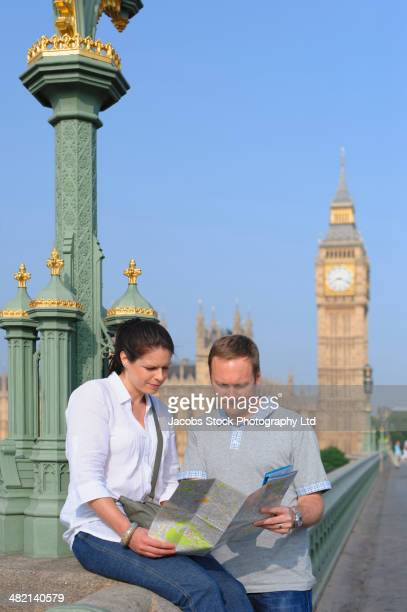 Couple reading map on Westminster Bridge, London, United Kingdom