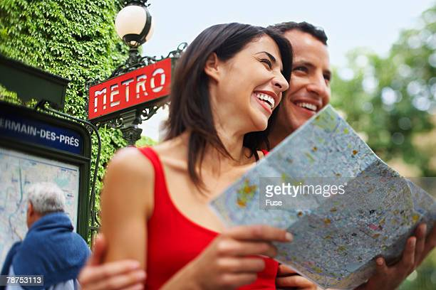 Couple Reading Map Outside Metro