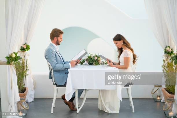 couple reading the menu in a romantic setting vacation honeymoon