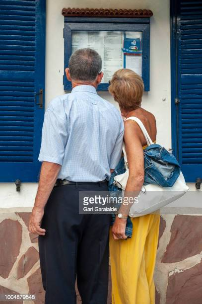A couple reading the menu of the Restaurante Hermandad de Pescadores on July 24 2018 in Hondarribia Spain The restaurant became famous when in 2011...
