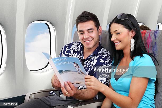 Couple Reading Travel Magazine