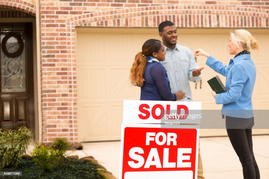 Couple receives keys to first home real estate purchase. : Stock Photo