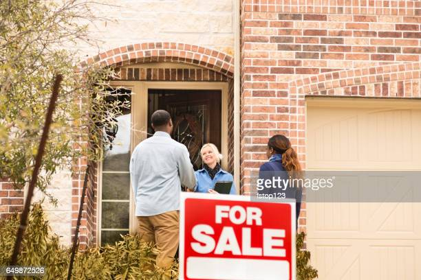 Couple receives keys to first home real estate purchase.